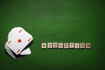 Addiction of playing cards concept isolated on green background
