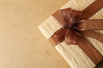 Beautiful gift with bow on wooden background