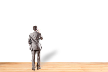 Manager in the office looking at the a summary, presentation or through a window. Businessman on a white background.