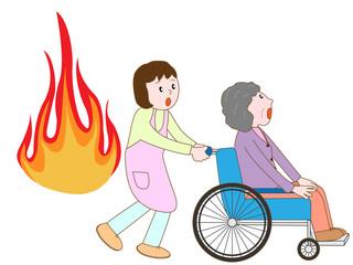 火災で車いす老人と介護士が避難する