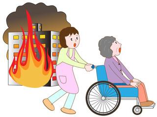 ビル火災で車いす老人と介護士が避難する