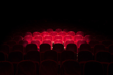 Lights on red seats in a theater