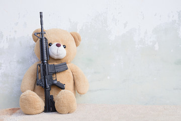 Teddy bear with toy gun