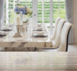 granite table top and blur of dining table and comfortable chair