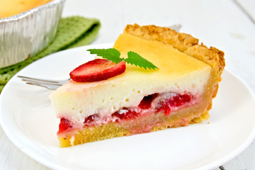 Pie strawberry with sour cream in dish on light board