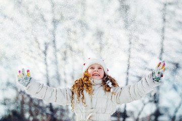 Little girl looking for falling snow.