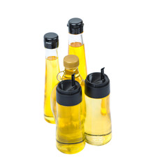 Sesame seed oil, flax seed oil, olive oil, corn oil and vegetable cooking oil in bottles over white background
