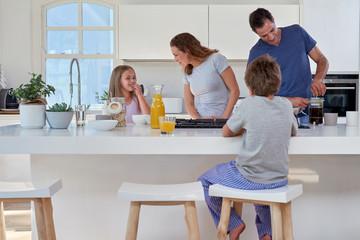 family in kitchen for breakfast