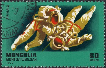 Astronauts in space.Postage stamp Mongolia 1977