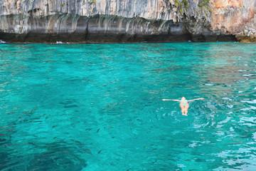 Woman floating in sea