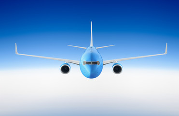 Wall Mural - Passenger airplane flying in the blue sky among the clouds