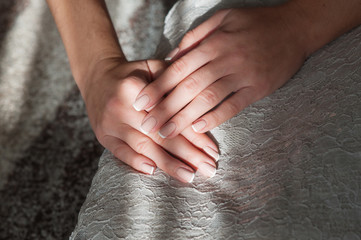 Set of nicely manicured fingernails with french manicure on dress