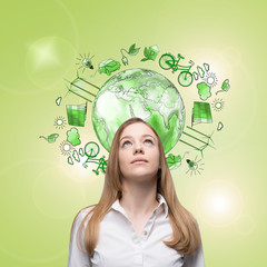 woman dreaming about clean environment, eco energy, protection