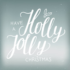 christmas calligraphy on ice background. have a holly jolly christmas