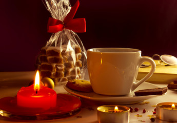 Coffee Mug, Cookies and Candles with Christmas decoration
