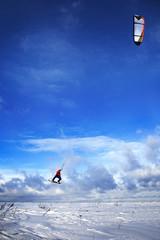 snowkiting man jumps on board to sky