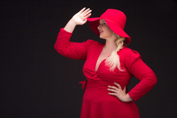 Sexy plus size woman in red hat with red lips.