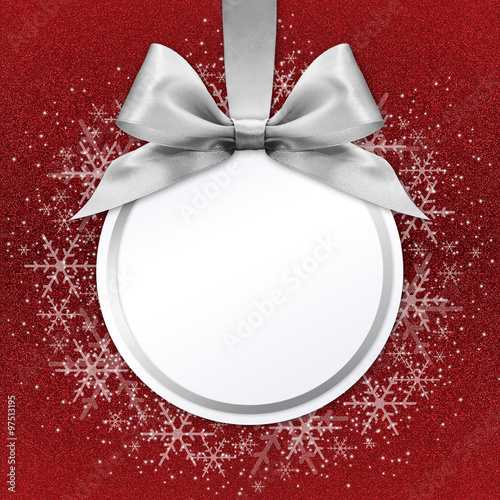 christmas ball with silver satin ribbon bow on red background ...