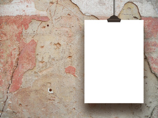 Single hanged paper sheet frame with clip on red and brown historic plastered wall background