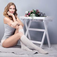 Sensual woman in lingerie posing.