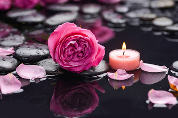 Papiers peints Spa rose petals with candle and therapy stones
