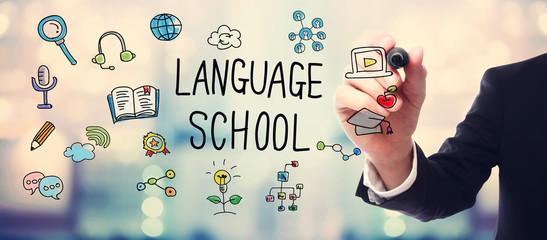 Businessman drawing Language School concept