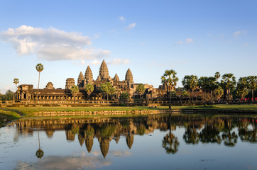 Angkor Wat at sunset with reflection in water