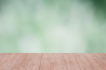 Wood table top on green bokeh abstract background. ready for product display