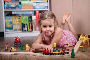 Girl play with a toy train