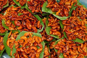 Sugar coated cashew nut on the foliage.