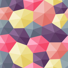 Seamless pattern created with faceted hexagons shaded to appear as 3D shapes.