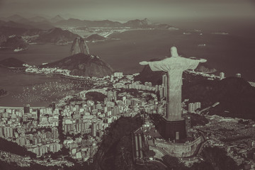 Aerial view of Christ and Botafogo Bay from high angle. Monochrome colors