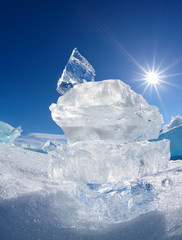 Ice floe crystal and sun over Baikal lake