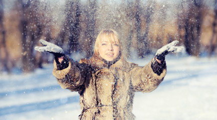 Young woman in the winter snowy scenery