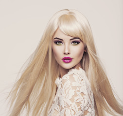 Beautiful  woman with long white straight  hairs and bright make