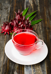 Fresh roselle juice (healthy drink) on wooden background