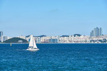 Yacht sailing on a background of Haeundae