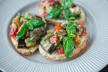Toast with baked eggplant with tomatoes, garlic