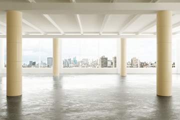 Modern hangar area with concrete floor and city view