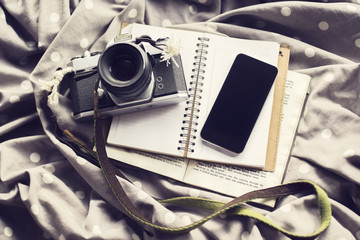 Vintage camera with blank black cell phone and blank diary, mock