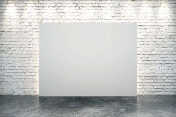 Blank white canvas in the center of white brick wall with concrete floor