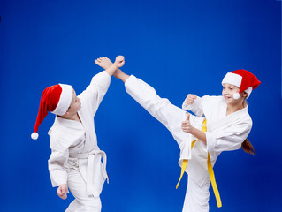Girl and boy are training paired exercises karate