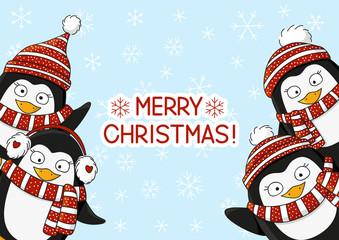 Christmas card with cute cartoon penguins