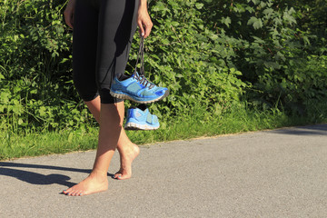 A woman goes barefoot after jogging