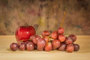 Still life with grapes and apple grunge background