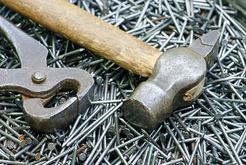 nail, pincers and  hammer