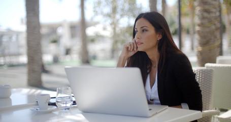 Businesswoman sitting thinking at a restaurant