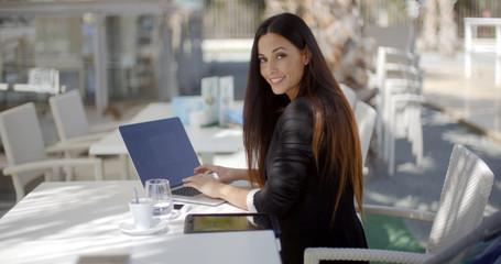 Elegant businesswoman working on a laptop