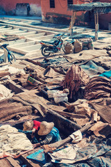 Workers in the tanneries of Marrakesh, Morocco.