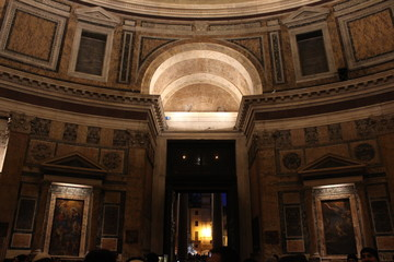 Pantheon interiors looking at the entrance at night in Rome, Italy